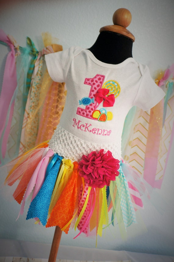 Baby Girls first birthday gum drops and lolipops applique bodysuit with matching fabric tutu.  Sized to fit a 1 year old. Bright colors.