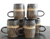 Geometric brown, black, and tan striped ceramic mug