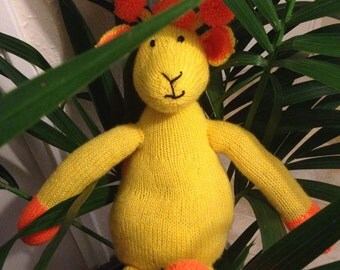 Hand knitted giraffe soft toy