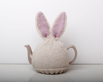 Knitted bunny rabbit tea cosy with pom pom bottom. Available with or without teapot. Fits 6 cup 1 litre pot.