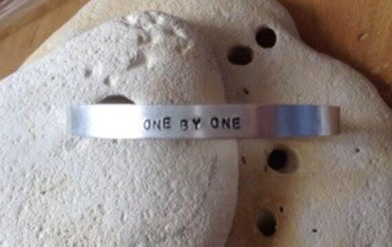 one by one animal adoption vegan bracelet - adjustable - handstamped - unisex