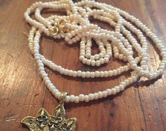 Pearl and gold crown necklace