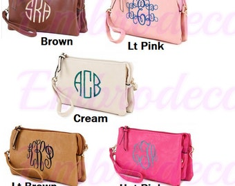 A Personalized clutch, a crossbody bag, and a wristlet all in one many colors to choose from