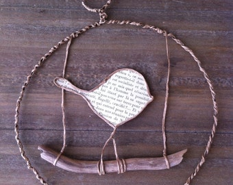 Bird mobile ornament made of wire and old French book pages