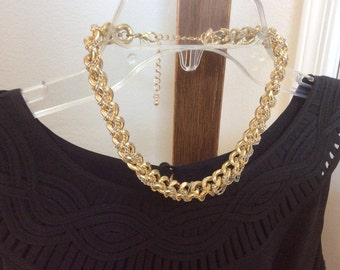 Heavy chain wrapped in little chains choker