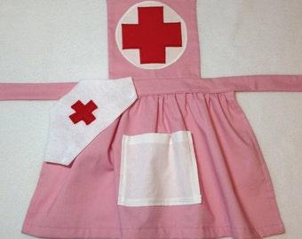 Pink child's nurse apron with hat. Dress up nurse costume.  Make believe nurse apron.  Add optional bandaids if desired.