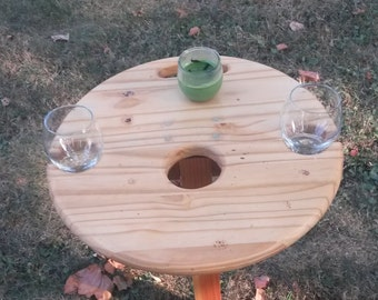 Outdoor table - wooden, folding table. Easy to tranport to your yard, the park, a beach, or any outdoor area. Custom finishes are available.