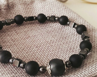 Bracelet made with matte black Onyx stones and Hematite.