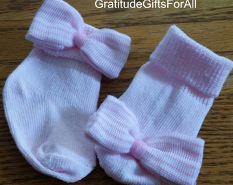 Newborn baby socks with bows! Available in White or Pink.  Bow Selection Offered Too! Every New Baby Girl Should Have These!