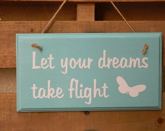 Let your dreams take flight sign