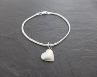 Sterling silver Snake bracelet with a Fine silver heart charm