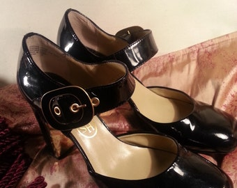 Ash brand size 39 Patten leather black with gold trim Mary Jane womens shoes with big gold buckle!