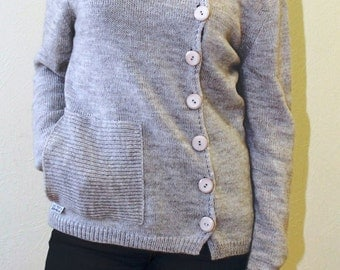 Jacket with buttons from merino wool. Asymmetric light brown woolen jacket with a collar and pockets.