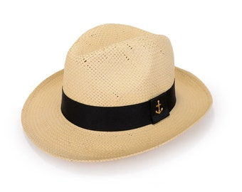 Panama beige hat , decorated with a black ribbon & a gold plated anchor rivet stud.