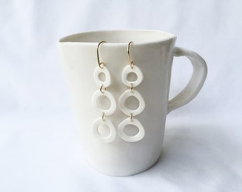 white porcelain three-tiered circles with gold earrings