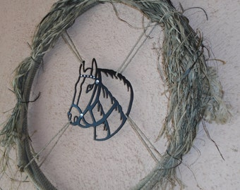 Western rope wreath.  Metal horse head wreath Western horse head and rope wreath. Rustic raffia, bling, rodeo rope decor.