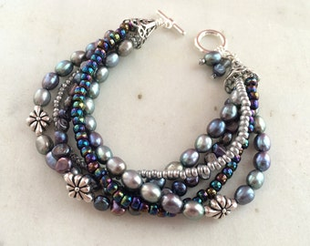 Multi strand pearl bracelet, peacock blue freshwater pearls, multi layer, seed bead bracelet. Sterling silver filled toggle. Sundance style.