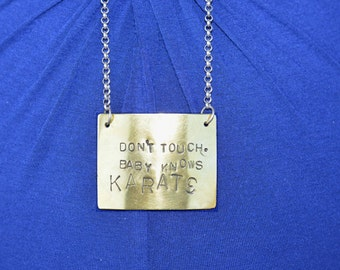 Don't touch, baby knows karate. Baby Bump necklace.