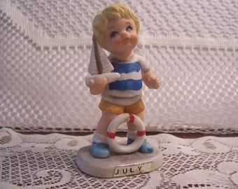 Enesco July Little Boy Figurine