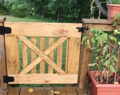 Farmhouse gate with open slats. Rustic farmhouse style.