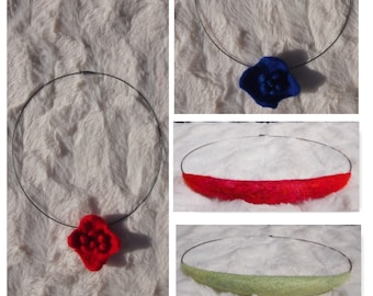 Silver colored necklace with hand felted accents, all handmade for you by Biddies.