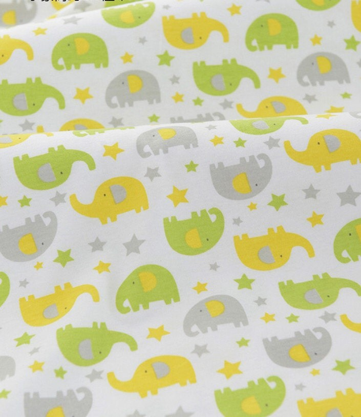 Cute baby knit fabric grey green yellow elephant by for Yellow baby fabric