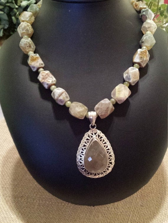 One strand beaded faceted necklace with sterling pendant