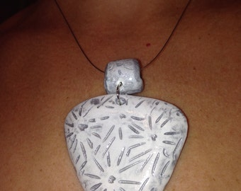 white and silver polymer clay pendant