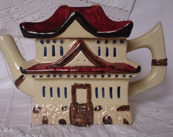 Pagoda teapot by Tony Woods. Collectible, functional teapot. Unusual pot from the International range, 1980s. Cream, blue and brown.