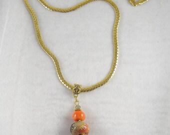 Pendant orange-red lampwork beads and golden details on big golden snake chain