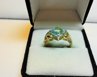 Swiss Blue Topaz Princess cut set in a sterling silver ring.