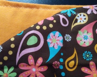 Brown and pink burp cloths