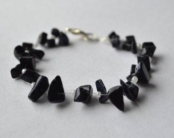 Sparkling black semi-precious stone and white bead bracelet