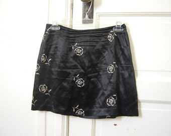 Silky Black Mini Skirt with Floral Embroidery