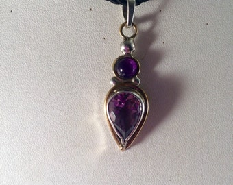 Sterling silver pendant with amethyst stones. Cord not included.