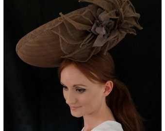 Bernadette by Rebecca's Millinery - statement handmade headpiece, secured with a covered headband and comb. Can be made in different colours