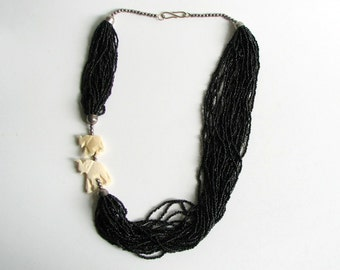 black torsade necklace with carved elephants . vintage tribal seed bead necklace . 24 strand glass necklace SALE