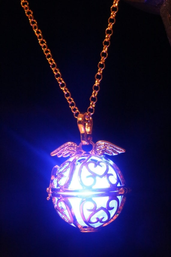 Necklace - Golden locket with glowing Orb with wings