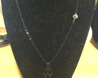 The Hands of Time necklace.