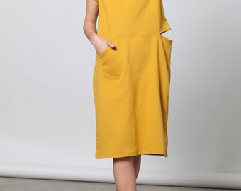 Pocket dress with a slit in cotton French terry