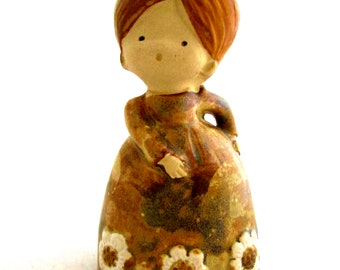 UCTCI Bell Girl Figurine Mid Century Japan Import Gold Foil Label Glazed Pottery Stoneware