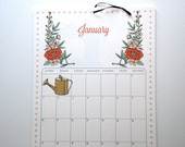 2016 Wall Calendar, sized 11x17 Inches featuring 12 different illustrations in coral, green, gold, gray, aqua and pink