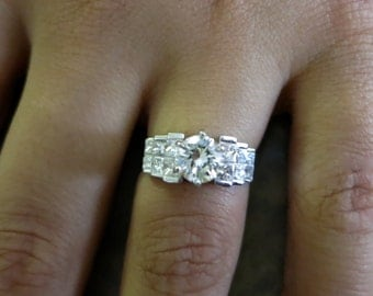 18K white gold round & princess cut diamonds.