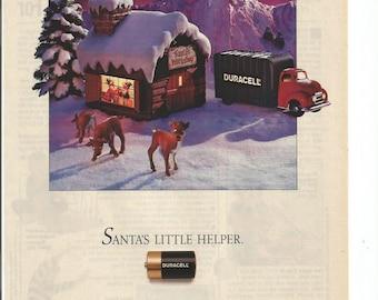 1989 Advertisement Duracell Batteries Christmas Santas Workshop Rudolph Little Helper Elves Reindeer Snow North Pole Wall Art