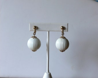 sarah cov dangel white clip earrings