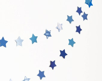 Stars garland in blue cardboards