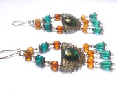 Bronze colour steampunk victorian goth chandelier earrings with amber yellow brown and emerald dark green glass beads.