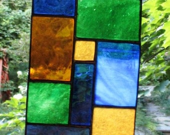 Stained Glass Panel of Browns, Green, Blue, and Amber AL123