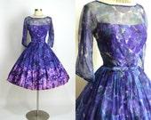 "FERMAN-O'GRADY 1950's 1960's Vintage Purple Blue Floral Printed Chiffon Acetate Illusion Neckline Cocktail Dress Party Dress 27"" Waist"