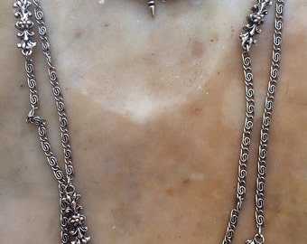 Vintage Heiress Long Textured Silver Tone Chain Necklace With Ornate Floral And Fleur De Lis Stations One Of A Kind